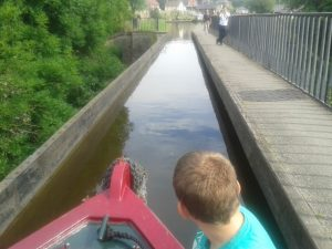 a view from the front of a canal boat crossing the pontcycllte aqueduct
