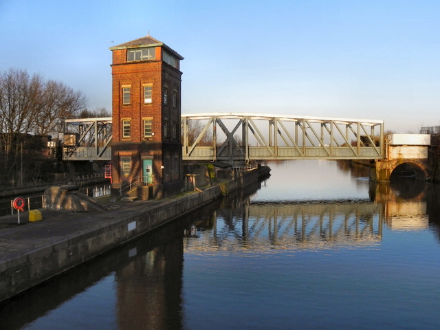 a picture showing the swing aqueduct and the control tower which carries the bridgewater canal over the manchester ship canal