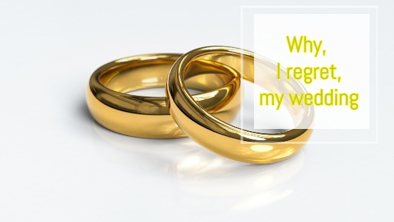 two gold rings with the text saying why I regret my wedding