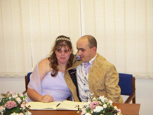 bride and groom signing the register in 2004 by an amateur photographer