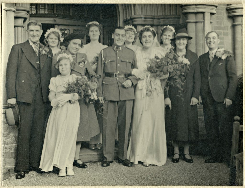 professional black and white photograph of the bride and grrom and wedding party taken in 1942