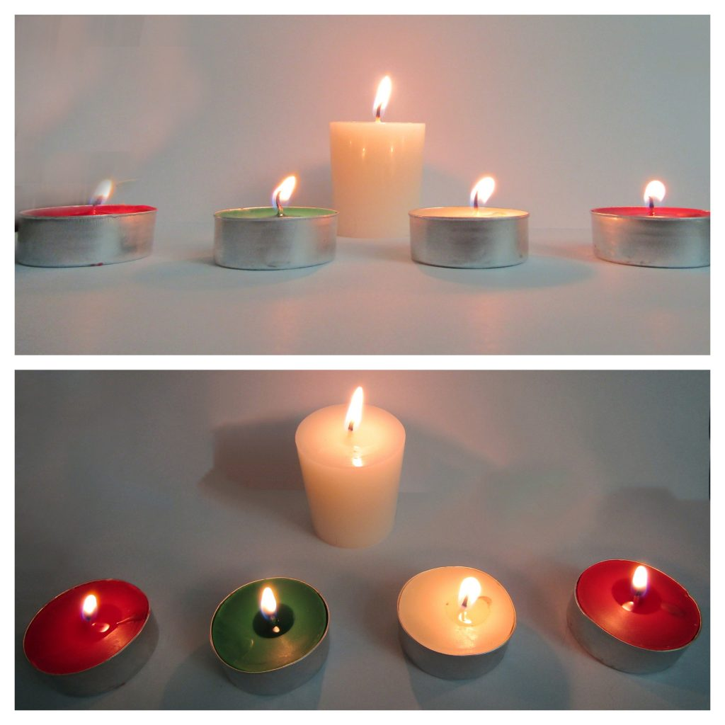 wow free stuff scented candles from the advent calendar lit, one large plain white, four small red, green, white and a different shade of red