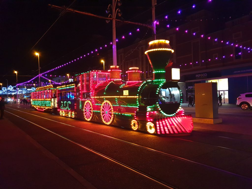 blackpool illuminated tram of steam train