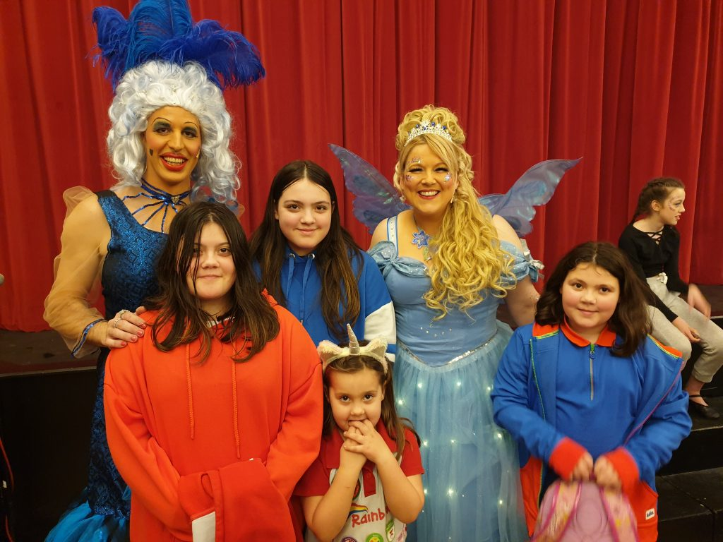 girls with panto characters of a fairy and widow twanky